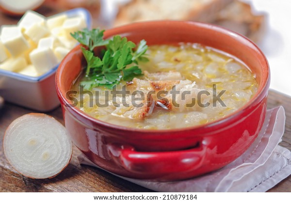 French onion soup in a red bowl