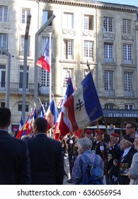 French parade of military veterans with flags flying. Taken in Bordeaux, France in September 2015.