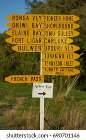 FRENCH PASS ROAD, MARLBOROUGH, NEW ZEALAND - APRIL 2016: Crowded yellow street signpost to French Pass in South Island, New Zealand.