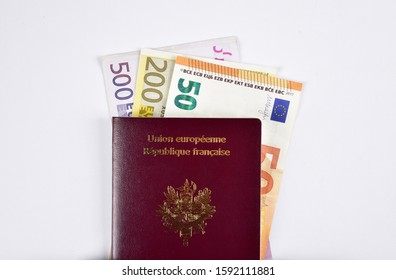 French passport and paper euro coins