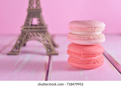 French pastel color macarons with Eiffel Tower background, souvenir from Paris. Romantic Style, Creative for colorful greeting card. Dream Destination. Sweet moment during journey.