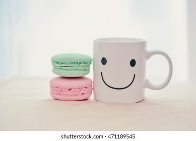 French pastel color macarons with happy cup. Concept about happiness and waiting for someone. (Soft Style for background)