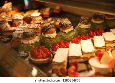 French pastries, different delicious desserts and cakes on display a confectionery bakery in Brittany, France