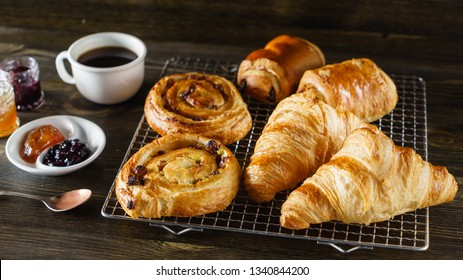 french pastries on the wooden background
