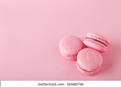 French pink macarons on pink background