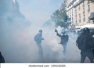 French police cover the street in tear gas on May Day, Paris, France 01/05/19