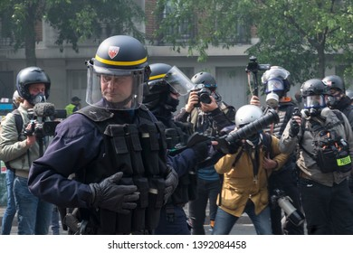 French police officers deploy across the road during the May Day protest in Paris, France. 01/05/19