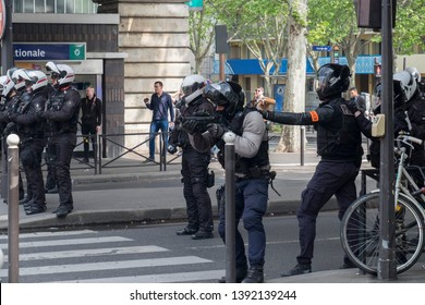 French police officers point weapons at protesters during the May Day protest in Paris, France. 01/05/19