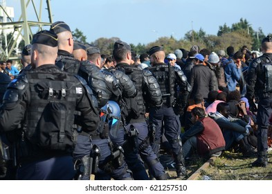 French police officers stands guard at the evacuation of the Jungle camp, Calais, France. October 2016