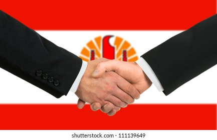 The French polynesia flag and business handshake