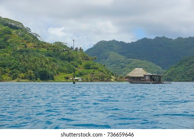 French Polynesia Huahine island coastline with a pearl oyster farm over the water in the lagoon, Faie, south Pacific ocean