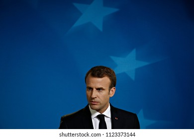 French President Emmanuel Macron speaks during a media conference at an EU summit in Brussels, Friday, June 29, 2018.