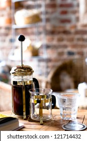 French press coffee and glass of water