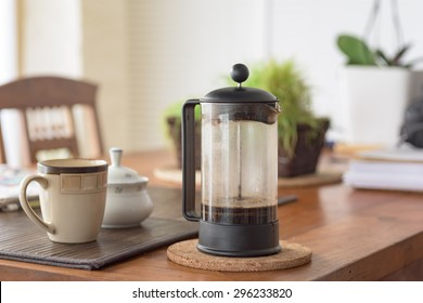 French press on the kitchen table