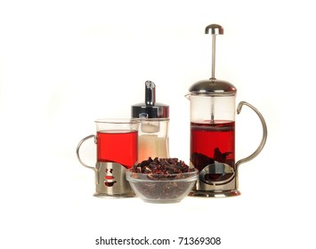 French press with tea over white