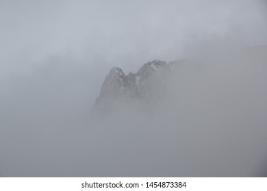 French pyrenees mountains under mistic grey fog