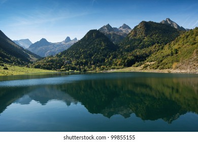 French Pyrenees reflecting in lake Lac Le Tech. Valley Arrens, Hautes-Pyrenees, France.