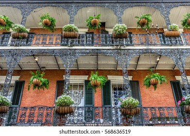 French Quarter Building with Balcony, Flowers and Green Plants in the French Quarter of New Orleans, LA USA