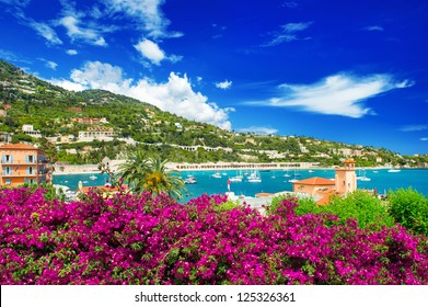 french reviera, view of luxury resort and bay of Villefranche-sur-Mer near Nice and Monaco. seafront landscape with azalea flowers