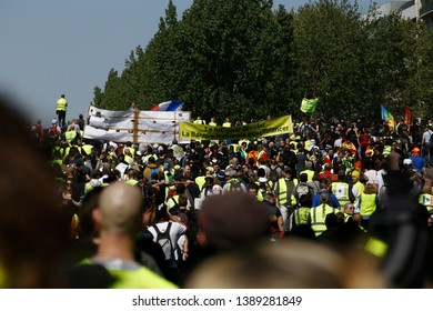 French riot police clash with French yellow vests protesters during a demonstration called by the Yellow vest movement against the policy of Emmanuel Macron  in Paris, France on Apr. 20, 2019