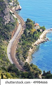 French Riviera with windy road, turquoise sea and villa from the top of mountain. France, Europe.