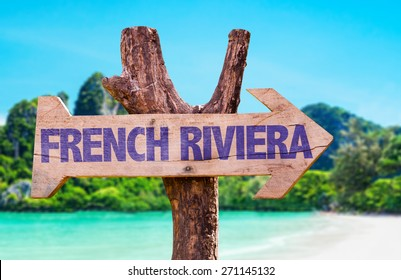 French Riviera wooden sign with beach background