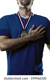 French soccer player, listening to the national anthem with his hand on his chest. On a white background.