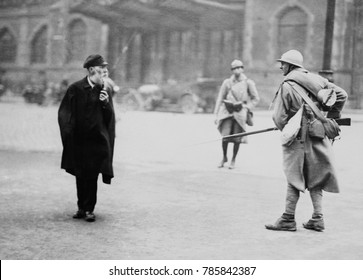 French soldier posted in front of the main Essen stations intimidates a elderly civilian, 1923. The French-Belgian occupation ruled with martial law