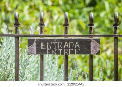 French and spanish entry signboard on a fence / Entry Signboard Background