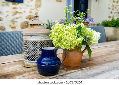 French still life outdoor with flowers on the garden table