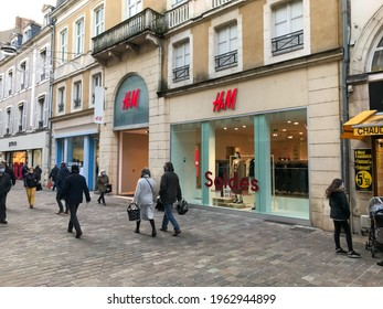 French store facade front of H and M brand in France. HM is a famous brand of clothes and fashion accessories. store facade with logo Hm French store facade front of H and M brand in France. HM