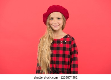 French style beret hat. Beret style inspiration. How wear beret like fashion girl. Kid little girl with long hair posing in hat and checkered dress on red background. Fashionable beret hat for female.