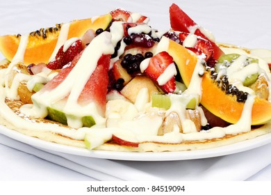 French style crepes with fresh fruits and custard cream on top
