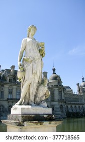 French style statue of a woman with an eagle lying at her feet
