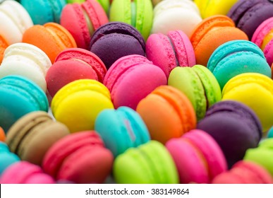 A french sweet delicacy, colourful macaroons variety closeup.Background Texture,