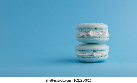 A french sweet delicacy, macaroons closeup.macaroon colourful on blue colour background.