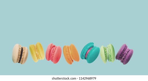 A french sweet delicacy, macaroons variety closeup.macaroon colourful texture.Cover banner cocept background food concept.