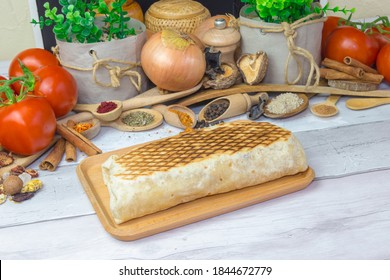 French Tacos Galette sandwich, served on a wooden table with food decoration