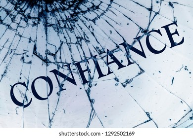 """The French text """"Trust"""" on the broken glass. Deceived hopes concept."""