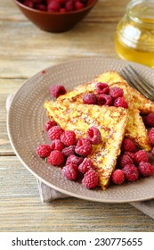 French toast with raspberries and honey on a plate, tasty food