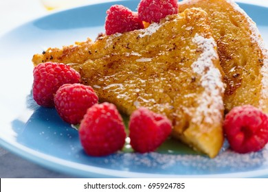 French toast with raspberries, sugar and honey