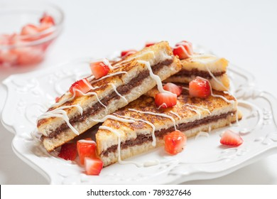 French toasts with hazelnut spread filling, strawberry and white chocolate