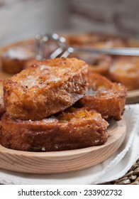 French toasts on a wooden plate. A delicious meal.