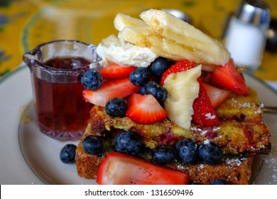 French toasts topped with various blueberry, strawberries, banan