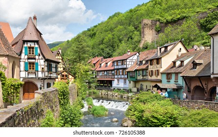 French traditional half-timbered houses and La Weiss river in Kayserberg village in Alsace, France
