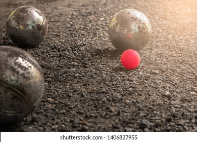 French traditional petanque game / Close up petanque bowls under the sun of Marseille. Sports and tourism concepts