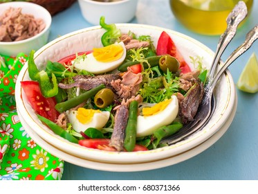 French traditional salad salade niçoise with tuna, vegetables and anchovy