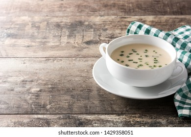 French vichyssoise soup in bowl on wooden table. Copyspace