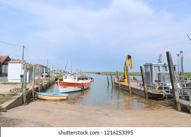 French wooden oyster huts and boats  in the Charente Maritime in France
