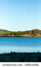 Frenchman lake at sunset land and water with full moon in the sky